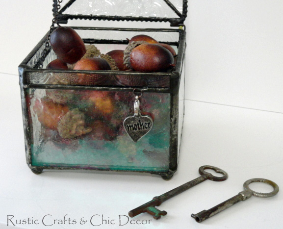 skeleton key next to pewter lined glass box with heart charm