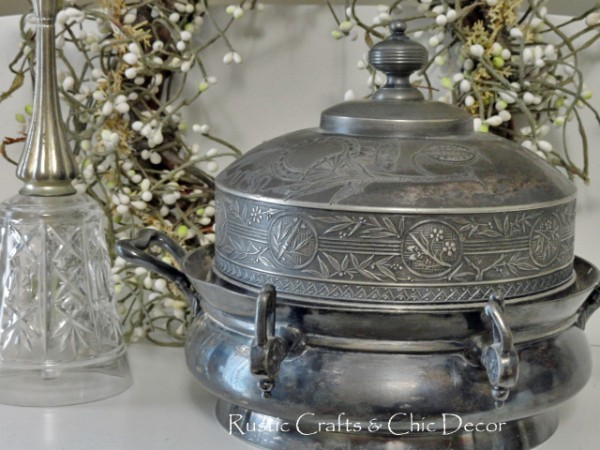 silver serving dish in front of white peaberry wreath