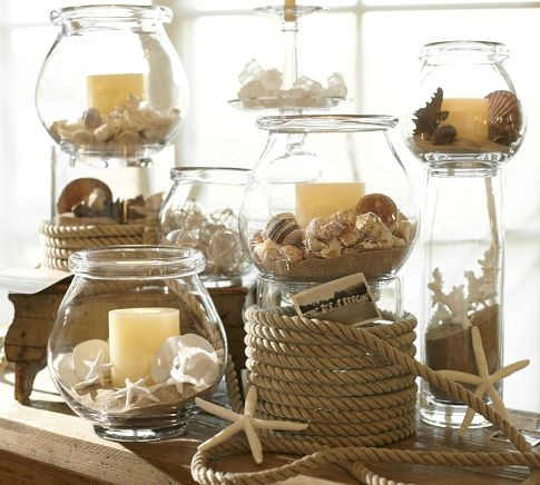 candle display with beach sand and shells