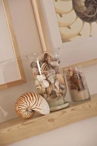 sand and seashell display in a glass jar