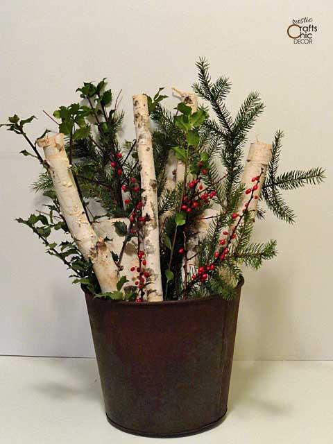 bucket of birch logs