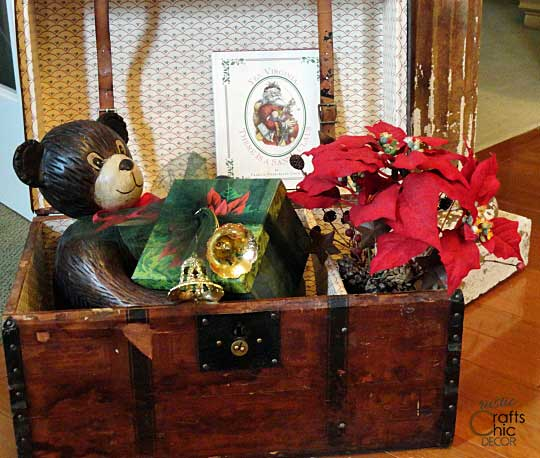 Christmas decor displayed in a vintage trunk