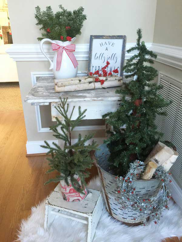 Christmas decor including birch logs and galvanized bucket