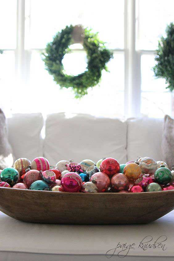 wooden bowl filled with Christmas ornaments