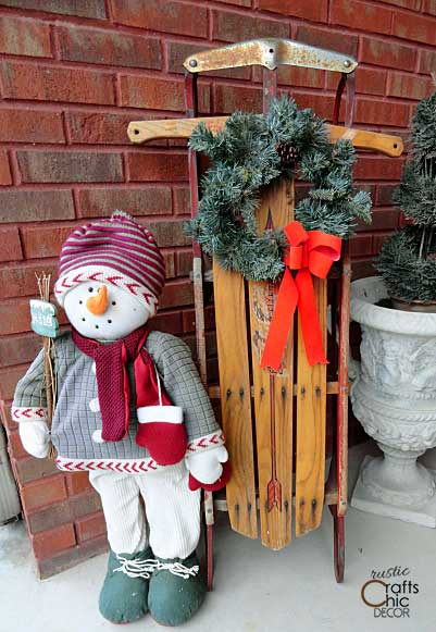 Christmas vintage sled and snowman outside