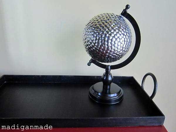 thumbtack covered globe