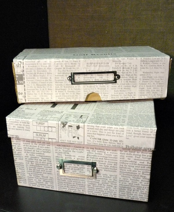 newspaper covered shoeboxes