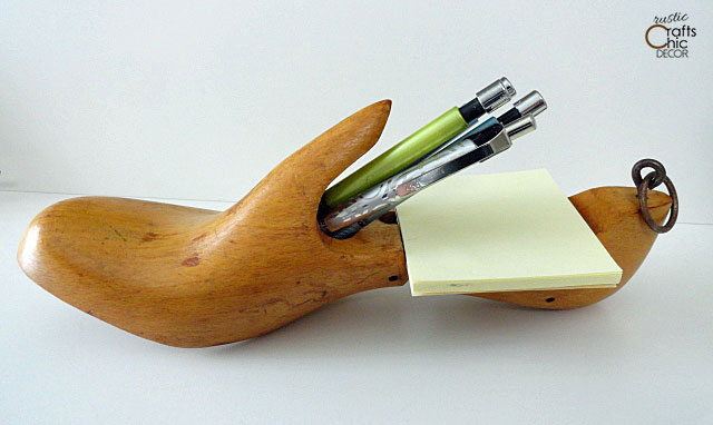 vintage wooden shoe mold as a holder for paper and pens