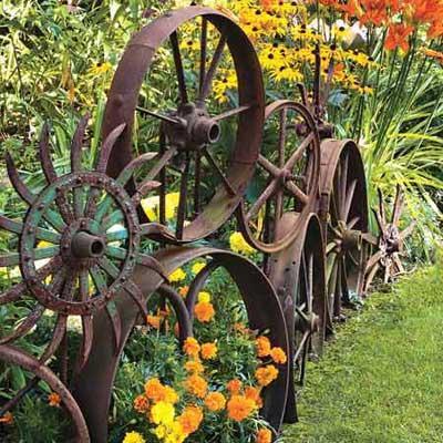 rustic garden ideas - rusty wheels