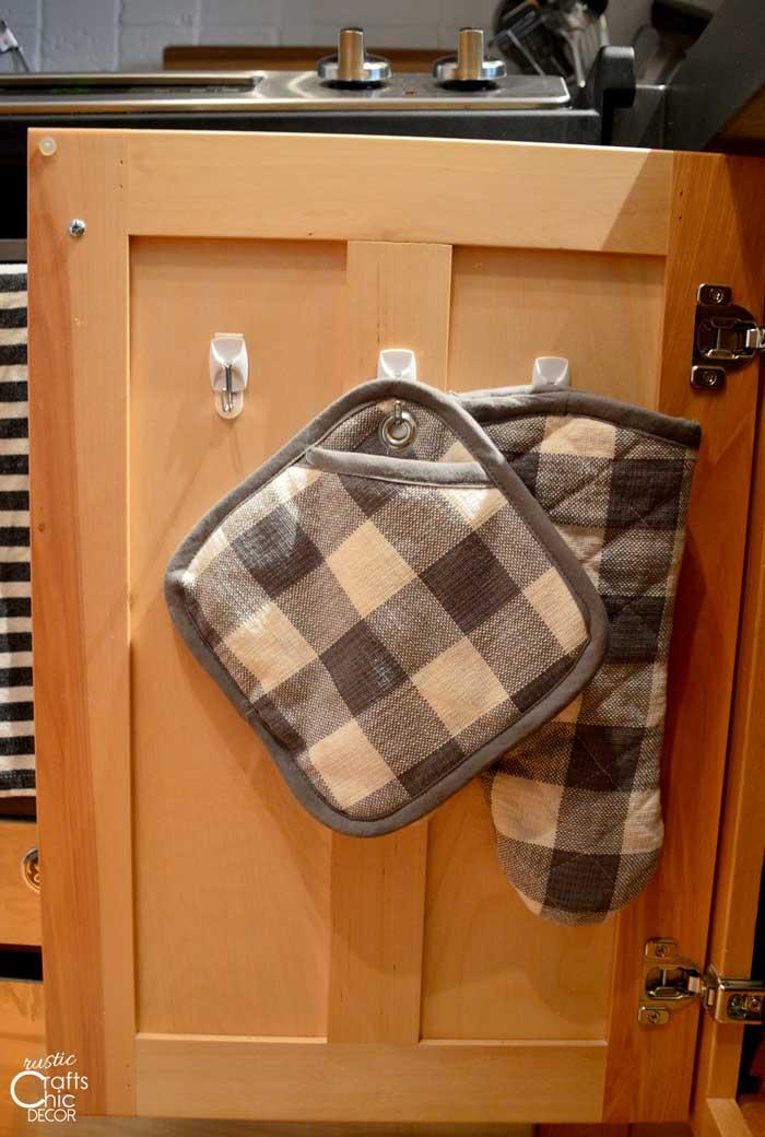 creative ideas to get organized - use hooks inside cabinet doors