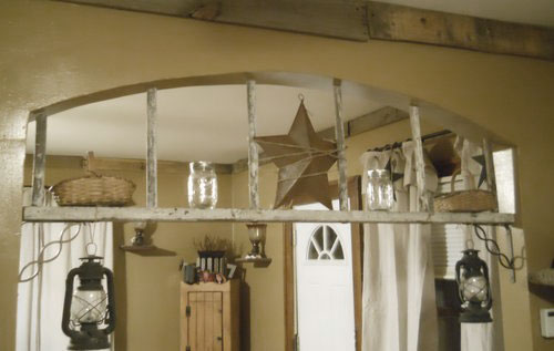 decorating with ladders - ladder archway beam