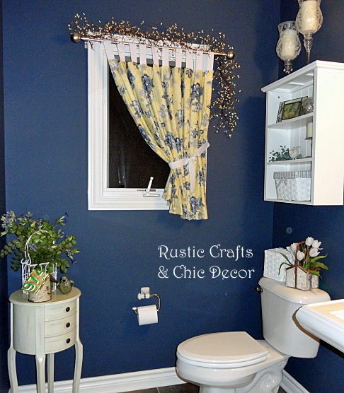 navy blue paint in powder room by rustic-crafts.com