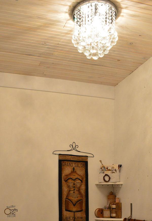 rustic chic decor DIY - hang a glitzy chandelier