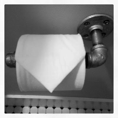 plumbers pipe toilet paper holder