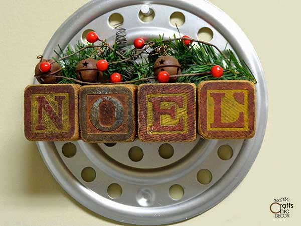 christmas wall art with vintage blocks spelling noel