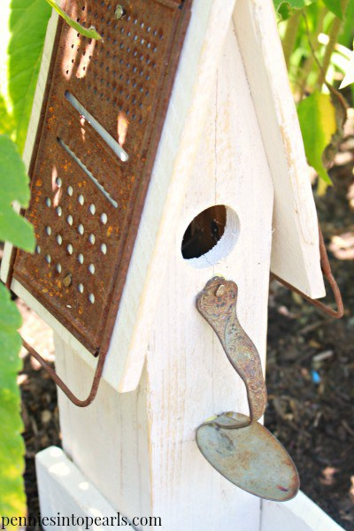 birdhouse made from pallet wood, a rusty grate and a spoon