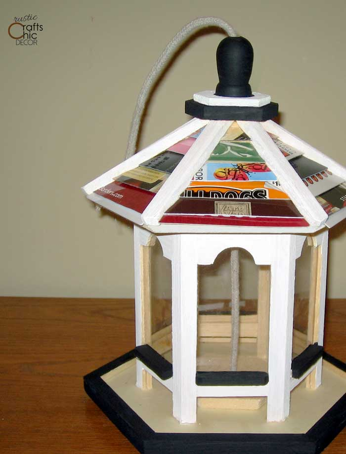 birdhouse decorated with credit cards