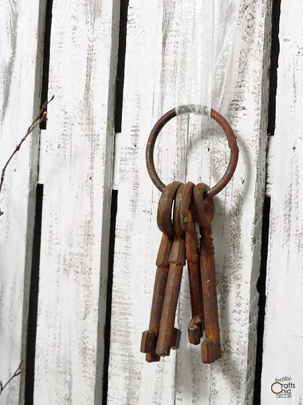 picket fence with old keys