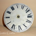 Clock face printable glued to a recycled cd.