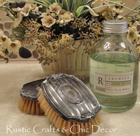 vintage brushes with bath oil and floral arrangement