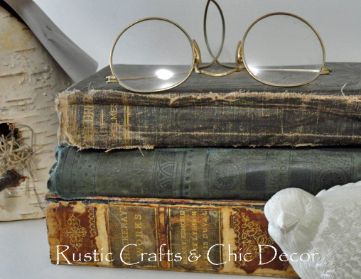 vintage books topped with old reading glasses