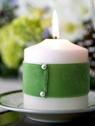 green ribbon wrapped candle for st. patricks day