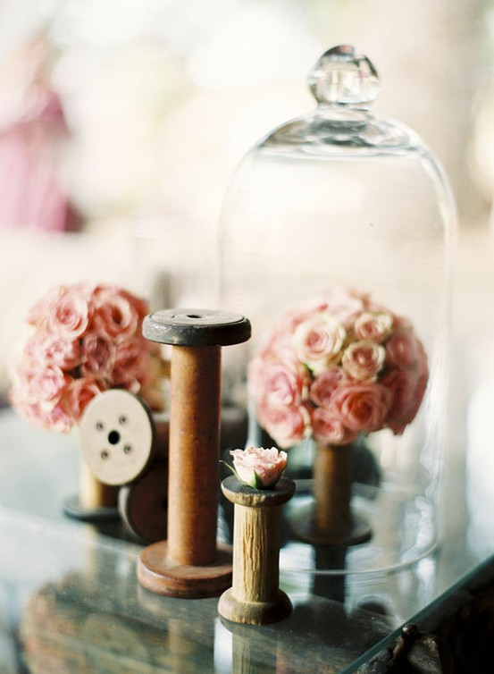 wooden bobbins and spools as vases