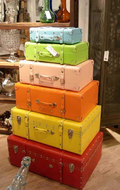 colorful painted stacked old suitcases