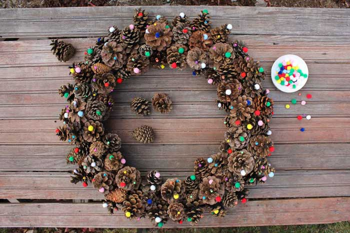 pine cone crafts wreath with pom poms