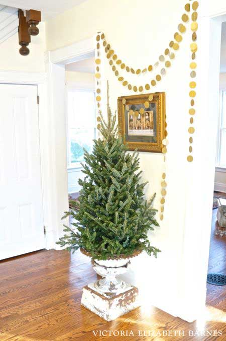 antique urn with a Christmas tree