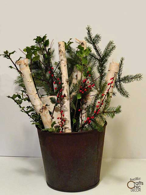 rustic bucket filled with Christmas cuttings