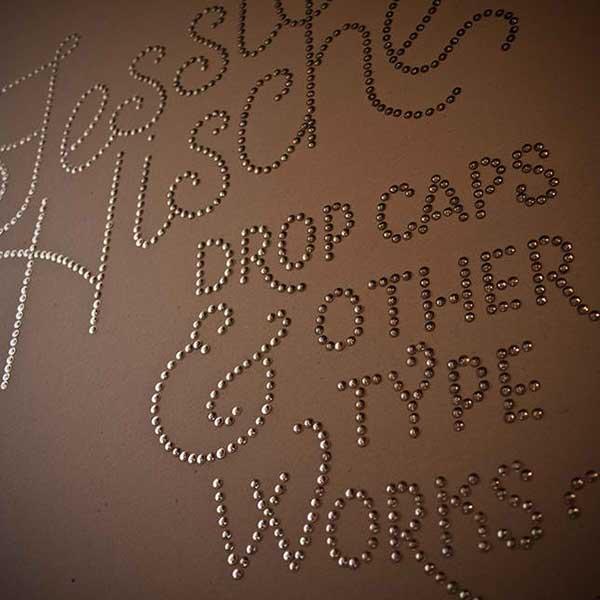 thumbtack wall typography