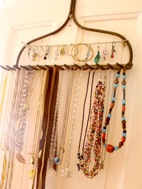 necklaces hung from an old rake