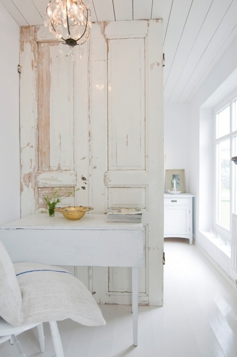 white room accented with distressed wood