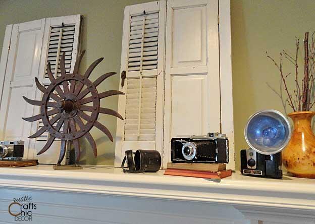 vintage camera display on mantel