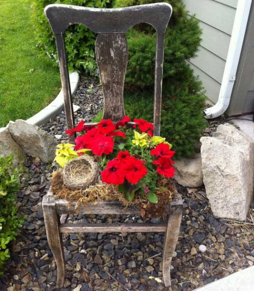 rustic garden ideas - weathered chair planter
