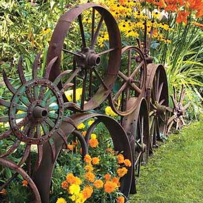 rustic garden ideas - rusty wheels