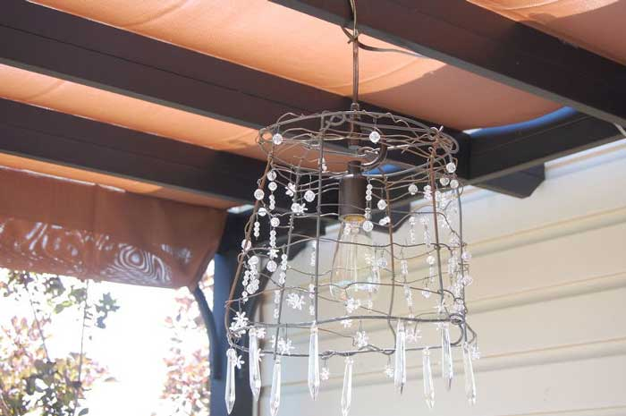 rustic outdoor decor ideas - tomato cage turned chandelier