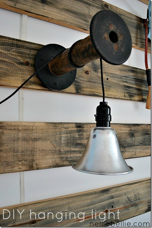 diy lighting with a shop light hung from vintage spool