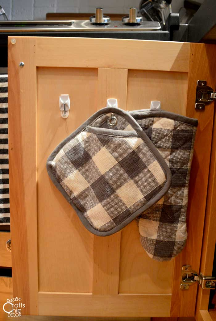 creative ideas to get organized - use hooks inside cabinet doors
