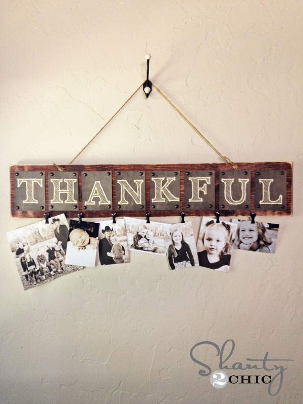 Photo display board with the word Thankful
