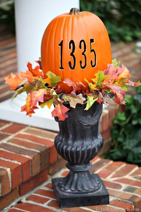 carved out address numbers in a pumpkin