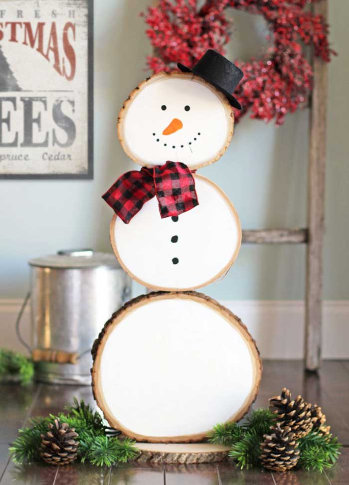 rustic snowman made from wood slices