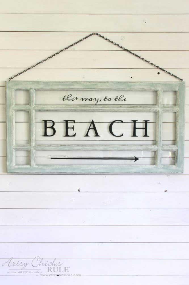 old window beach sign