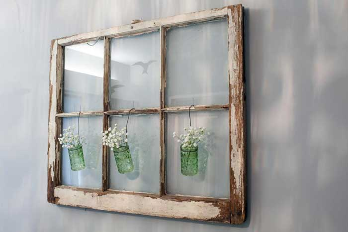 old window with hanging vases