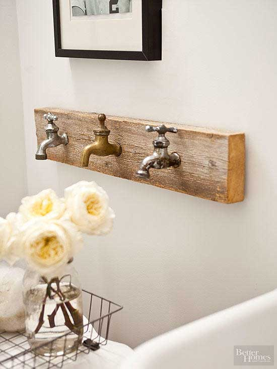 rustic cabin bathroom decor - vintage faucet towel rack