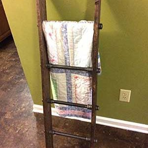 rustic industrial pipe blanket ladder