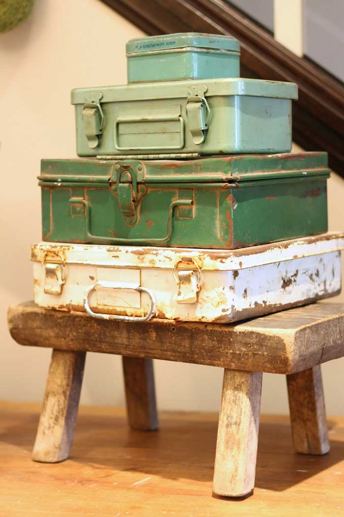 stacked vintage tool boxes