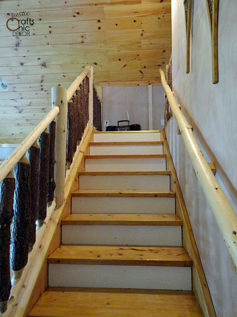 rustic stair rail made from logs