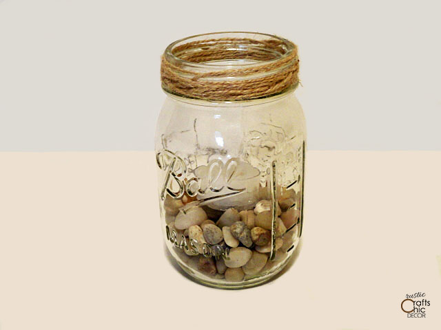 mason jar filled with rocks and tea light